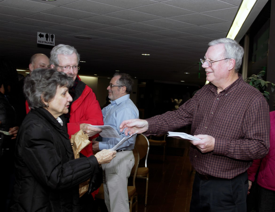 Passing out programs to guests at St. John's Annual Christmas concert on December 8, 2016.